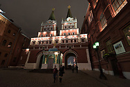 People walk through an archway into Red Square, Moscow