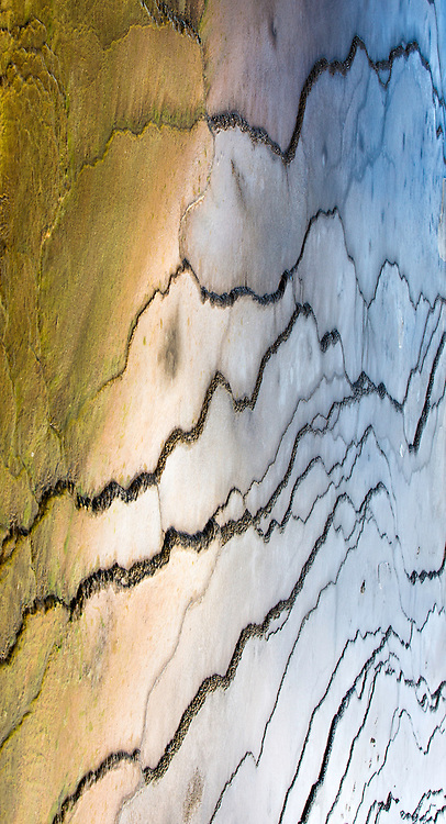 Rule breaker is one of tracie spence' favorite hot spring images due to the natural beautiful colors green, blue, yellow, and pink of microorganisms that live on the grounds surface.