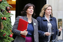"© Licensed to London News Pictures. 18/12/2018. London, UK. Claire Perry - Minister of State at Department for Business Energy and Industrial Strategy (L) and Penny Mordaunt - Secretary of State for International Development and Equalities Minister (R) departs from No 10 Downing Street after attending the weekly Cabinet Meeting that discussed the preparations for a ""No Deal"" Brexit. Photo credit: Dinendra Haria/LNP"