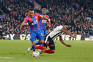 Crystal Palace striker striker Jordan Ayew (14) is taken out by a challenge from Grimsby Town midfielder Mitch Rose (8), which led to the only goal of the match during The FA Cup 3rd round match between Crystal Palace and Grimsby Town FC at Selhurst Park, London, England on 5 January 2019.