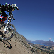 Sarah Atkin from Lower Hutt in action during the New Zealand South Island Downhill Cup Mountain Bike series held on The Remarkables face with a stunning backdrop of the Wakatipu Basin. 150 riders took part in the two day event. Queenstown, Otago, New Zealand. 9th January 2012. Photo Tim Clayton