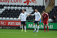 England's Nathan Redmond (11) celebrates with teammate Carl Jenkinson after he scores his sides 2nd goal. UEFA 2015 European U21 championship, group one qualifier , Wales u21 v England u21 at the Liberty Stadium in Swansea, South Wales on Monday 19th May 2014. <br /> pic by Andrew Orchard, Andrew Orchard sports photography.