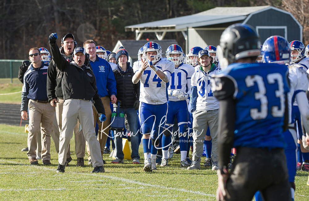 Interlakes Head Coach Jon Francis reacts to an interception made by Andrew Brothers during Saturday's NHIAA semi final football with Winnisquam.  (Karen Bobotas/for the Laconia Daily Sun)