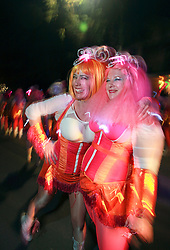 12 Feb 2015. New Orleans, Louisiana.<br /> Mardi Gras. Pussyfooters make their way along Magazine Street  with the The Krewe of Muses. <br /> Photo; Charlie Varley/varleypix.com