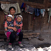 China, People, Tibetan farmers, Mother and twin Children. Sichuan, China.