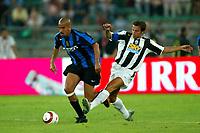 Bari 3/8/2004 Trofeo Birra Moretti - Juventus Inter Palermo. <br /> <br /> Juan Sebastian Veron Inter challenged by Alessandro Del Piero Juventus <br /> <br /> Risultati / results (gare da 45 min. each game 45 min.) <br /> <br /> Juventus - Inter 1-0 Palermo - Inter 2-1 Juventus b. Palermo dopo/after shoot out <br /> <br /> Photo Andrea Staccioli
