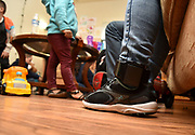 Tucson, Arizona, USA.  9 Jan, 2019. Asylum seekers, who entered the USA from Mexico through the port-of-entry at Nogales, Arizona, receive shelter and services at Casa Alitas operated by Catholic Community Services of Southern Arizona, Inc.  After processing, where adults were fitted with ankle bracelets and assigned a hearing date, the dozen migrants, including adults and children from Guatemala and Mexico, were brought to the shelter by Department of Homeland Security agents.  After a brief stay at the shelter, they will travel to the location of their sponsor until their hearing date.  Casa Alitas is one of many shelters caring for migrants.  Credit:  Norma Jean Gargasz/Alamy Live News