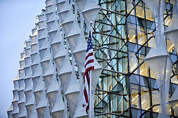 © Licensed to London News Pictures. 12/01/2018. LONDON, UK.  The Stars and Stripes flag is seen outside the new US Embassy in Nine Elms, designed by US firm Kieran Timberlake.  Donald Trump, President of the United States, has stated that he will not be visiting the UK for the upcoming opening of the property amidst protest fears.  Instead, Rex Tillerson, US Secretary of State, will attend in his place.  Photo credit: Stephen Chung/LNP