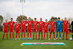 WREXHAM, WALES - Wednesday, October 30, 2019: Wales players line-up before the 2019 Victory Shield match between Wales and Republic of Ireland at Colliers Park. (L-R) Aaron Bennett, Cameron Congreve, Morgan Williams, Joel Cotterill, Ruben Davies, Here Hewitt-White, Kai Ludvigsen, Kian Jenkins, Zachary Bell, goalkeeper Ronnie Hollinghshead, captain Zak Williams. (Pic by David Rawcliffe/Propaganda)