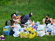 25 JUNE 2020 - DES MOINES, IOWA: Supporters of Black Lives Matter sort groceries donated to BLM to help the homeless. Nearly 100 volunteers came to a community support event organized by Black Lives Matter in Good Park in Des Moines. They sorted supplies donated to BLM, including food, sanitary supplies, first aid supplies, batteries, blankets, tents, and bottled water. The emergency packages will be distributed to homeless people in Des Moines.        PHOTO BY JACK KURTZ