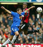 Photograph: Scott Heavey,  Digitalsport<br /> Chelsea v Manchester City. FA BArclaycard Premiership. 25/10/2003. Adrian Mutu has his shirt pulled by City captain Sylvain Distin