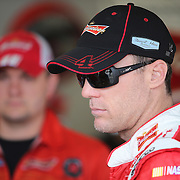 Driver Kevin Harvick is seen in the garage area during the 56th Annual NASCAR Daytona 500 practice session at Daytona International Speedway on Saturday, February 22, 2014 in Daytona Beach, Florida.  (AP Photo/Alex Menendez)