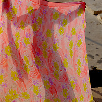 A woman's shadow is seen on a sari as she launders clothes along the Ganges River in Varanasi, India.<br /> Photo by Shmuel Thaler <br /> shmuel_thaler@yahoo.com www.shmuelthaler.com
