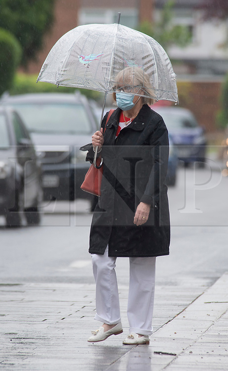 © Licensed to London News Pictures 04/06/2021. Sidcup, UK. No more sunny weather today as the rain makes a comeback in South East London as people in Sidcup High Street get their umbrellas out. Photo credit:Grant Falvey/LNP