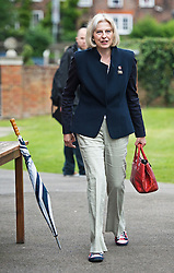 © London News Pictures. 25/08/2012. Henley-on-Thames, UK. Home Secretary Theresa May wearing Union Flag shoes during a meeting with the Team GB Rowing squad before they take part in a 'Heroes Return' Open-top bus tour through the town of Henley-on-Thames in Oxfordshire on August 25, 2012. The GB rowing squad won a total of nine medals at the 2012 London Olympics including four golds.  Photo credit : Ben Cawthra/LNP