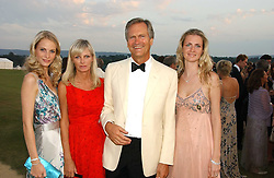 Left to right, POPPY DELEVINGNE, CHARLES & PANDORA DELEVINGNE and CHLOE DELEVINGNE at the Cowdray Gold Cup Golden Jubilee Ball held at Cowdray Park Polo Club, on 21st July 2006.<br /><br />NON EXCLUSIVE - WORLD RIGHTS