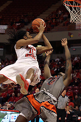 17 December 2014:  Tony Wills flies backwards to the basket knocking down Javier Martinez and getting called for an offensive contact penalty on his way to the hoop during an NCAA Men's Basketball game between the Skyhawks of University of Tennessee - Martin and the Redbirds of Illinois State at Redbird Arena in Normal Illinois