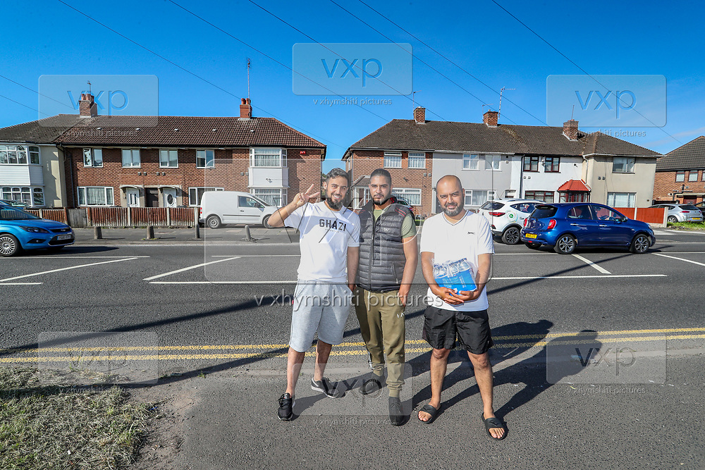 Birmingham, United Kingdom, June 14, 2021: Local residents appear to be trying to provide water for Palestine Action activists at the scene in Kitts Green in Birmingham after Palestine Action activists say they are 'occupying' the site claiming the company 'provided cladding for Grenfell Tower' and 'materials for Israel's fighter jets.' (Photo by Vudi Xhymshiti)