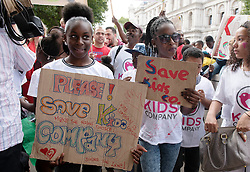 © Licensed to London News Pictures. 07/08/2015. <br /> LONDON, UK. Children participate in a Kids Company protest on Whitehall after the charity closed on Wednesday, London, Friday 07 August 2015. Photo credit : Hannah McKay/LNP