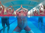 Members of The Ministry of Fun's Santa School, dressed as Father Christmas,  work out to get 'chimney-ready' as they attend a special  Santa Boot Camp at the new David Lloyd Club, Newbury PRESS ASSOCIATION Photo. Picture date: Tuesday November 24, 2015. The super intensive pre-Christmas training programme included sessions in David Lloyd's state-of-the-art gym to build strength for all that heavy present lifting, a Santa Spin Session, an Aqua class in the heated pool for stamina and sleigh-ready agility, a bespoke 'Legs, Bums and Tums' class with the emphasis on Santa-sized 'Tums' – and Yoga. Photo credit should read: Chris Ison/PA Wire