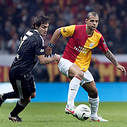 Galatasaray's Felipe Melo (R) and Besiktas's Veli Kavlak (L) Action picture during their Turkish superleague soccer derby match Galatasaray between Besiktas at the TT Arena at Seyrantepe in Istanbul Turkey on Sunday, 26 February 2012. Photo by TURKPIX
