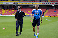 Quique Flores, the Watford manager walking on the pitch with Dean Austin, the Watford assistant manager before k/o. Barclays Premier League, Watford v Swansea city at Vicarage Road in London on Saturday 12th September 2015.<br /> pic by John Patrick Fletcher, Andrew Orchard sports photography.