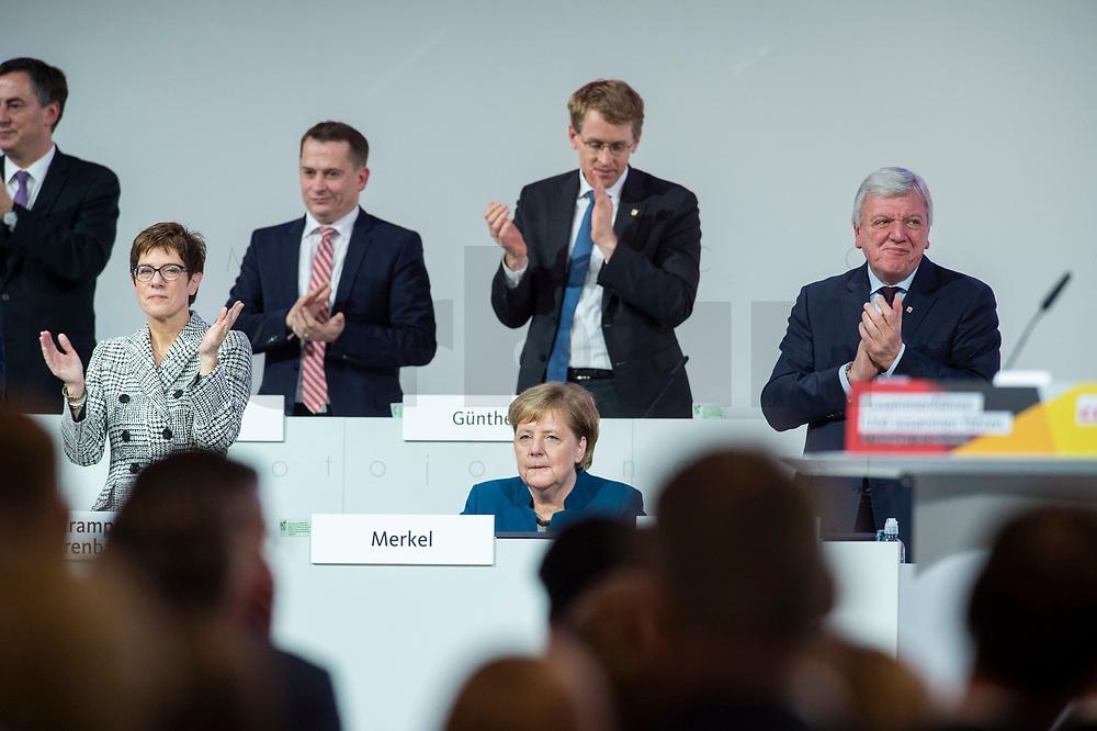 07 DEC 2018, HAMBURG/GERMANY:<br /> Angela Merkel, CDU, Bundeskanzlerin, nach Ihrer letzten Rede als Parteivorsitzende, unten links: Annegret Kramp-Karrenbauer, CDU Generalsekretaerin, unten rechts: Volker Bouvier, CDU, Ministerpraesident Hessen, hinten v.L.n.R.: Dr. Roland Heintze, CDU Landesvorsitzender Hamburg, Daniel Guenther, CDU, Ministerpraesident Schleswig-Holstein, CDU Bundesparteitag, Messe Hamburg<br /> IMAGE: 20181207-01-079<br /> KEYWORDS: party congress, Appluas, applaudiren, klatschen, Jubel, Daniel Günther