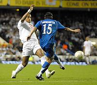 Photo: Ed Godden/Sportsbeat Images.<br /> Tottenham Hotspur v Anorthosis Famagusta. UEFA Cup, First Leg. 20/09/2007. Spurs' Tom Huddlestone (L), challenges Costas Loumpoutis.