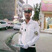 Police man. In Zahedan city, capital of Sistan Baluchistan province in south east Iran, near the border with Afghanistan. <br /> <br /> Travelling over 4000km by train across Iran. An opportunity to enjoy Persian hospitality, discover Iran's ancient cities and its varied landscapes, from deserts to mountains.