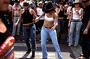 Dancing and drinking on the streets of Barretos, Brazil during the Rodeo Championships; any excuse to party! Aug 2001.