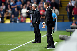 Manchester United manager Jose Mourinho (left) gestures on the touchline