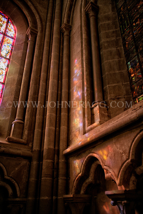 Gorgeous stained glass reflection in the Cathedral of Notre Dame of Lausanne, Switzerland