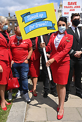 © Licensed to London News Pictures. 23/06/2021. London, UK. Protesters representing the UK travel industry take part in a demonstration in Westminster highlighting the situation the current border and travel restrictions due to the Covid 19 pandemic. Industry estimates show more than a third (37 per cent) of the UK's 526,000 travel and tourism jobs could be wiped out due to the pandemic. Photo credit: Ray Tang/LNP