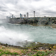 High resolution panorama of the American Falls (at left) at Niagara Falls on the Niagara River on the border between the United States and Canada. In the distance, just to the left of the buildings, are the larger Horseshoe Falls (or Canadian Falls).