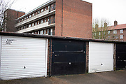 Lock up garages in a council estate of social housing Wapping on 24th February 2020 in London, United Kingdom. These garage buildings are separate and external to the homes they belong to and are built in rows. Lock-ups have a reputation as places where illegal storage takes place, although this myth is unfounded, and likely to be based on the prevalence of these buildings being used for criminal activity on crime dramas on tv.