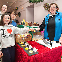Sibling's Amy, Ian and Katy try some locally produced cheeses from Margaret Howard from the Aillwee Caves Burren Gold Cheese Stall at the Ballyvaughan Christmas Fair