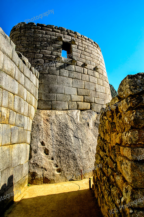 Temple of the sun is locatedin the center of Machu Picchu's Urban center. Built on top of a rock and above the Royal Cave