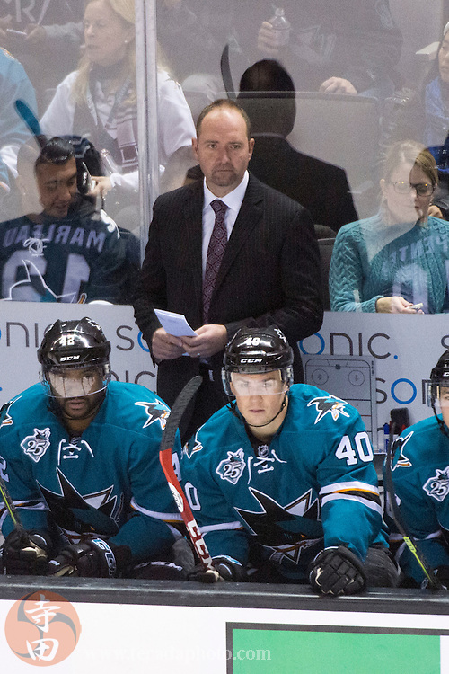 December 12, 2015; San Jose, CA, USA; San Jose Sharks head coach Peter DeBoer watches from behind the bench during the third period against the Minnesota Wild at SAP Center at San Jose. The Wild defeated the Sharks 2-0.