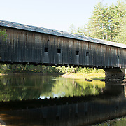 Hemlock Bridge, built in 1857, is a 109 foot Paddleford truss strengthened with laminated wooden arches. It was built on granite abutments since it was located in a floodplain.<br /> <br /> The bridge was reinforced to carry local traffic in 1988. Hemlock Bridge was designated as a Maine Historic Civil Engineering Landmark by the American Society of Civil Engineers in 2002.<br /> <br /> It is located three miles northwest of East Fryeburg over an old channel of the Saco River.