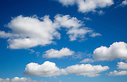 Blue sky and white fluffy cumulus clouds over Suffolk, England, UK