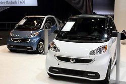 "12 February 2015:  2015 SMART FORTWO: Designed and engineered by Mercedes-Benz, the 2015 Smart ForTwo is a lean, mean, good looking machine. As the iconic mircocar, the Smart is available in three gasoline-powered models, as well as the fully-electric ForTwo. Trim levels include the Pure Coupe, Passion Coupe, Passion Cabriolet and Electric Drive model. Powering the 1,808 lb automobile is a one-liter, in-line three-cylinder gasoline engine that creates 70-horsepower to the rear-wheels. The Electric Drive uses a 51-kW electric motor with lithium-ion battery that generates 41-hp. All Smart ForTwo's come mated to a five-speed smartshift transmission with automatic (for ease) and manual (for fun) modes. Cargo room for the two-seater is a surprising 12.0-cu. ft. Since safety is paramount, the ForTwo comes packed with features including the protective ""tridion safety cell,"" to help ensure crash compatibility with larger passenger cars, plus electronic stability program, anti-lock braking system and eight airbags. There is seven exterior colors to choose from, and two tridon safety cell colors. Interior can be decked out in six different colors, in leather and color upholstery. For the young and young at heart, the ForTwo offers 14 separate, customizable body panel graphics, or you can come up with your own designs and the company will wrap your Smart however you like. Make sure to check-out the Brabus sport package that transform the Smart into a fiercer dream machine with bolder exterior treatment and eye-catching cockpit.<br /> <br /> First staged in 1901, the Chicago Auto Show is the largest auto show in North America and has been held more times than any other auto exposition on the continent. The 2015 show marks the 107th edition of the Chicago Auto Show. It has been  presented by the Chicago Automobile Trade Association (CATA) since 1935.  It is held at McCormick Place, Chicago Illinois"