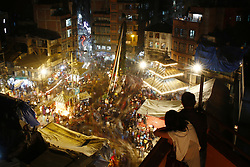April 4, 2017 - Kathmandu, Nepal - Nepalese devotees circle around the chariot of Seto Machindranath for worship during the chariot festival in Kathmandu, Nepal on Tuesday, April 04, 2017. Seto Machindranath is a Deity worshiped by the Hindus and Buddhists for rainfall and good harvest. (Credit Image: © Skanda Gautam via ZUMA Wire)