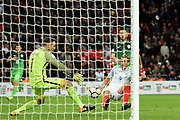 England forward Harry Kane scores a goal (1-0) during the FIFA World Cup Qualifier match between England and Slovenia at Wembley Stadium, London, England on 5 October 2017. Photo by Martin Cole.