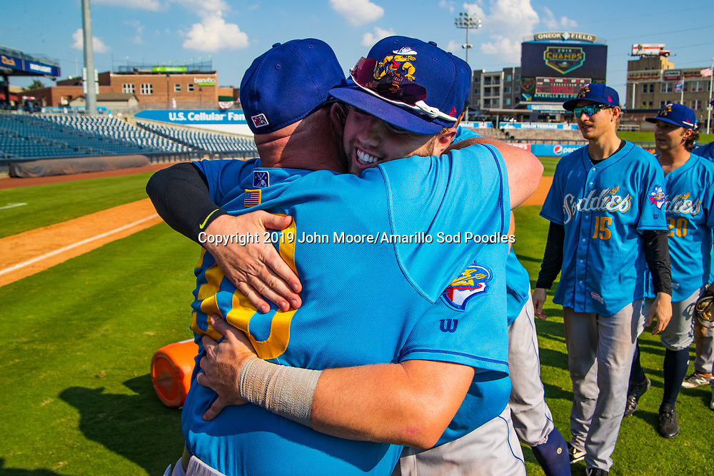 Amarillo Sod Poodles Manager Phillip Wellman and Amarillo Sod Poodles infielder Owen Miller (14) celebrates after the Sod Poodles won against the Tulsa Drillers during the Texas League Championship on Sunday, Sept. 15, 2019, at OneOK Field in Tulsa, Oklahoma. [Photo by John Moore/Amarillo Sod Poodles]