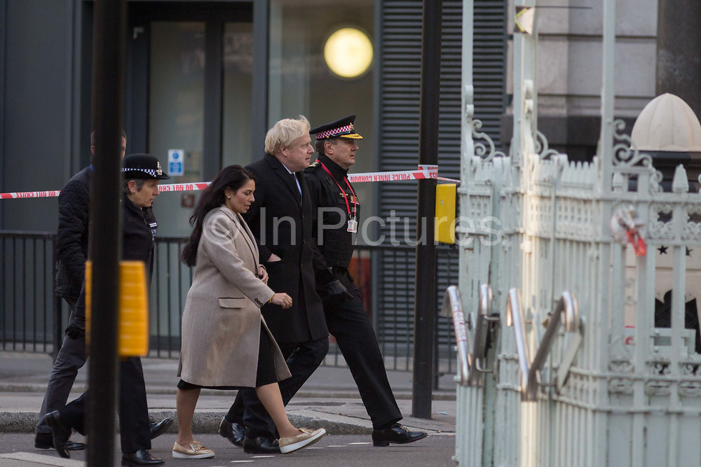The morning after the terrorist attack at Fishmongers Hall on London Bridge, in which Usman Khan a convicted, freed terrorist killed 2 during a knife a attack, then subsequently tackled by passers-by and shot by armed police - Met Police Commissioner Cressida Dick; Home Secretary Priti Patel; Prime  Minister Boris Johnson, and City of London Commissioner Ian Dyson leave the cordon after viewing the crime scene, on 30th November 2019, in London, England.