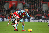 Football - 2017 / 2018 Premier League - Southampton vs. Burnley<br /> <br /> Steven Defour of Burnley shrugs Southampton's Nathan Redmond off the ball at St Mary's Stadium Southampton<br /> <br /> COLORSPORT/SHAUN BOGGUST