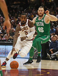 October 17, 2017 - Cleveland, OH, USA - The Cleveland Cavaliers' JR Smith drives around the Boston Celtics' Aron Baynes in the first quarter on Tuesday, Oct. 17, 2017, at Quicken Loans Arena in Cleveland. (Credit Image: © Leah Klafczynski/TNS via ZUMA Wire)