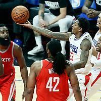 28 February 2018: LA Clippers guard Lou Williams (23) goes for the layup past Houston Rockets guard Joe Johnson (7) and Houston Rockets center Nene Hilario (42) during the Houston Rockets 105-92 victory over the LA Clippers, at the Staples Center, Los Angeles, California, USA.