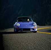 Image of a blue 1974 Porsche 911 RS sports car in Washington state, Pacific Northwest, model and property released by Randy Wells