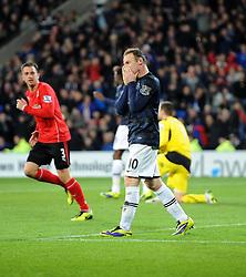 Man Utd Forward Wayne Rooney (ENG) cuts a frustrated figure - Photo mandatory by-line: Joseph Meredith/JMP - Tel: Mobile: 07966 386802 - 24/11/2013 - SPORT - FOOTBALL - Cardiff City Stadium - Cardiff City v Manchester United - Barclays Premier League.